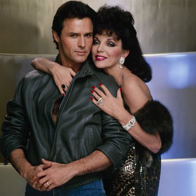 Michael Nader with Dynasty co-star Joan Collins in 1985.