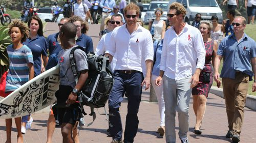 Prince Harry on Durban beach as he views the Surfers Not Street Children project.