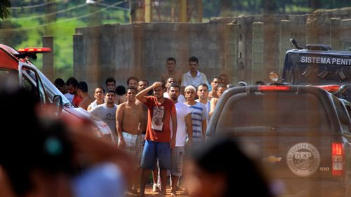 Prisoners try to contact relatives after a rebellion at the Colonia Agroindustrial prison in the Aparecida de Goiania Complex. (AP)