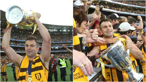 Lake with the premiership cup after winning the Grand Final with the Hawks in 2013. (AAP)