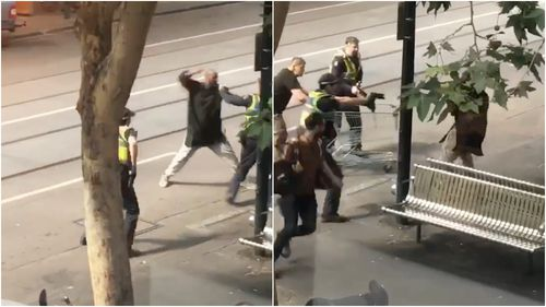 The attacker goes towards police with a knife.