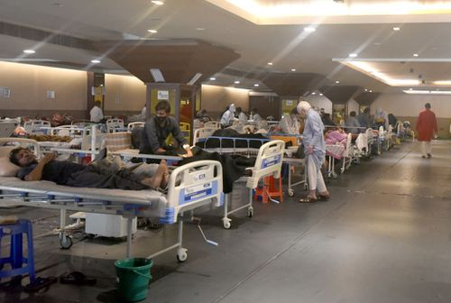 Coronavirus patients relax at Shehnai Banquet Hall Covid-19 care centre, attached to LNJP Hospital  in New Delhi.
