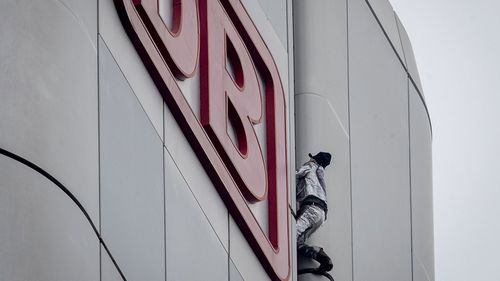 """French urban climber Alain Robert, well known as """"Spiderman"""", climbs up the Deutsche Bahn high-rise in central Frankfurt, Germany, Thursday, October 1, 2020"""