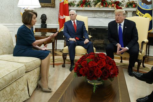 Nancy Pelosi (left) argues with Donald Trump (right) as Mike Pence looks on during a White meeting on December 11, 2018.