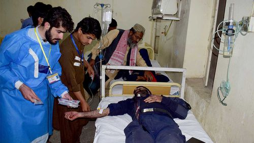 Injured victims of a bomb blast are treated at a hospital in Quetta, Pakistan.