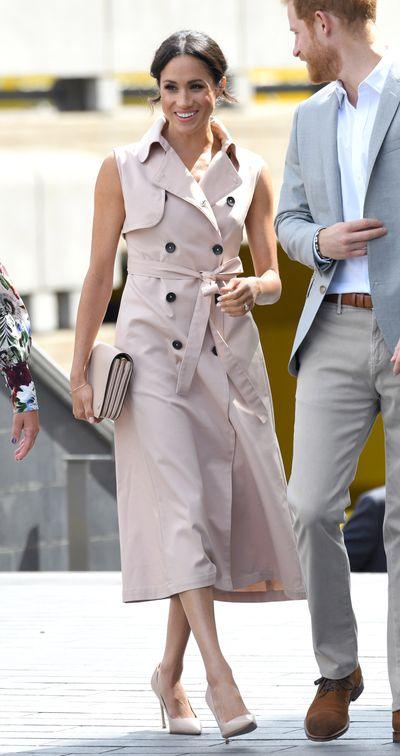 """<p><a href=""""https://style.nine.com.au/2018/07/12/09/29/meghan-markle-ireland-outfits-designers-givenchy"""" target=""""_blank"""" title=""""Meghan Markle"""" draggable=""""false"""">Meghan Markle</a> has certainly been busy with royal outings this month.</p> <p>From Prince Louis christening and her two-day visit to Dublin, to her<a href=""""https://style.nine.com.au/2018/07/15/20/20/meghan-markle-emma-watson-wimbledon"""" target=""""_blank"""" title="""" Wimbledonouting """" draggable=""""false""""> Wimbledon outing </a>with sister in law <a href=""""https://style.nine.com.au/2018/07/16/13/17/kate-middleton-stylish-wimbledon-outfits"""" target=""""_blank"""" title=""""Kate Middleton"""" draggable=""""false"""">Kate Middleton</a>, the newlywed has nailed it in the style stakes on every occasion.</p> <p>Her latest outing is no different.</p> <p>The former actress stepped out overnight to the Nelson Mandela Centenary Exhibition&nbsp;with husband Prince Harry at the Southbank Centre in London, wearing a sleeveless trench dress from Canadian ready-to-wear label, NONIE.</p> <p>The blush-coloured dress featured bold black buttons, a structured collar and a loose sash tied at the waist. She complimented her look with a matching pink Mulberry clutch, nude pumps, and wore her nails the same shade of blush as her dress.</p> <p>Nina Kharey, founder and creative director of NONIE, told <em>People</em> that she was thrilled to see the <em>Suits</em> star in her design.</p> <p>""""Seeing Meghan Markle wear the&nbsp;NONIE Trench Dress&nbsp;today with such elegance and grace is beyond exciting!"""" she gushed. """"Her continuous support of Canadian brands is remarkable, and it is a true honor to be the first Canadian based ready-to-wear designer she has worn since her wedding earlier this year.""""</p> <p>The $1,118 dress wasn't a new purchase from the 36 year-old. Markle brought the dress from the brand's Spring/Summer 2018 collection back in 2017 while still living in Toronto.</p> <p>Markle's latest look is one in a long line of sartorial stand-outs from the s"""