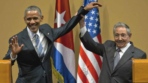Perhaps his most significant foreign policy decision, Obama ended a financial embargo on Cuba that had been in place since the early 1960s. In this awkward picture with Raul Castro, Obama took the first steps towards normalising relations with one of the US's closest neighbours. (AP)