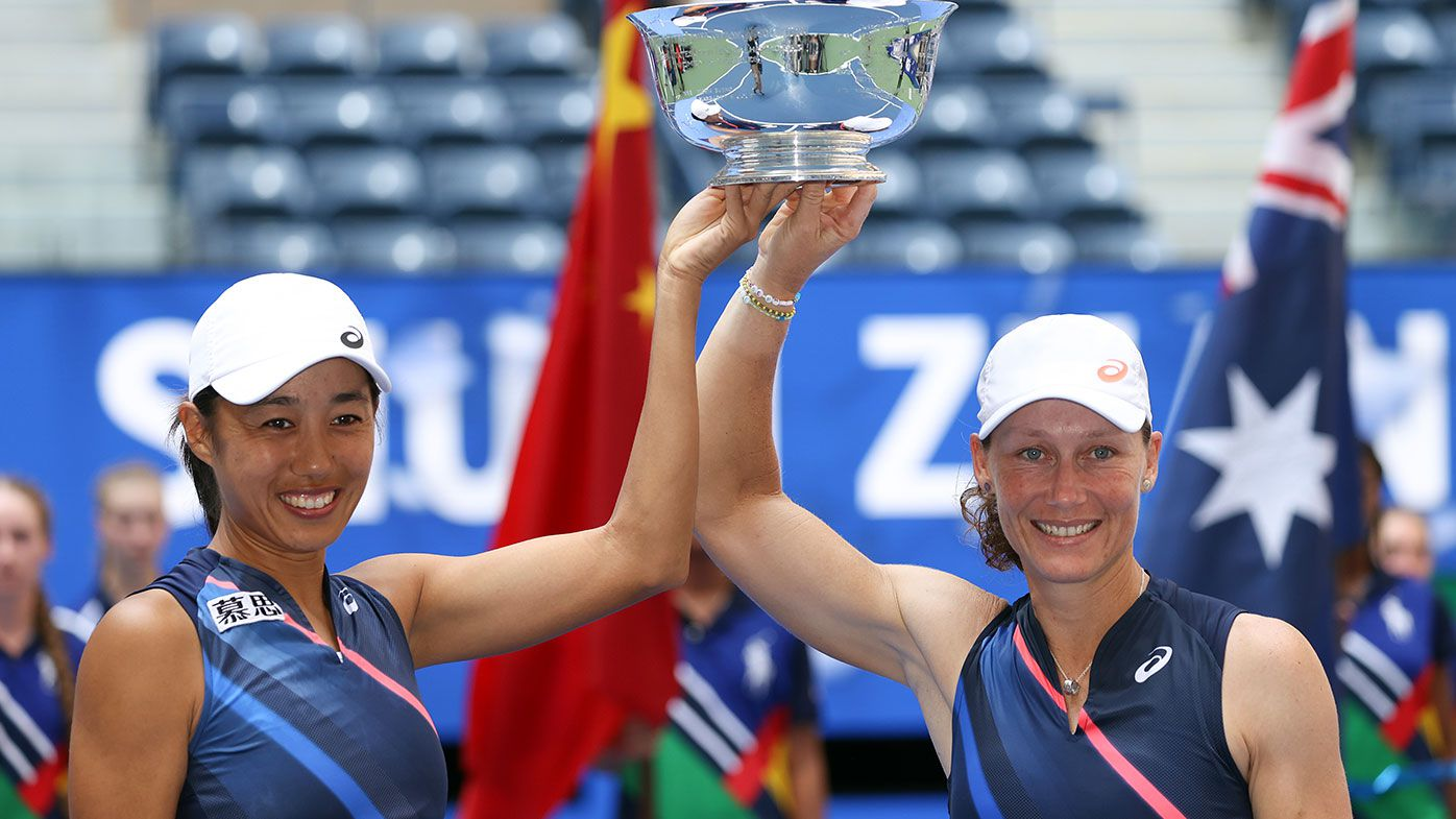 Shuai Zhang of China and Samantha Stosur of Australia celebrate with the championship trophy after defeating Coco Gauff of the United States and Catherine McNally of the United States during their Women's Doubles final match on Day Fourteen of the 2021 US Open at the USTA Billie Jean King National Tennis Center on September 12, 2021 in the Flushing neighborhood of the Queens borough of New York City. (Photo by Al Bello/Getty Images)