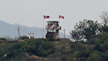In this May 3, 2020, file photo, a North Korean flag flutters in the wind at a military guard post in Paju, at the border with North Korea