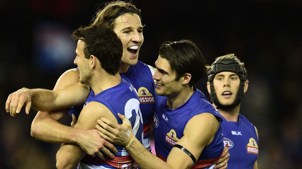The Bulldogs celebrate after defeating the Hawks.(AAP)