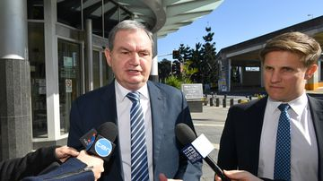 Former Ipswich mayor Paul Pisasale (left) is seen leaving the Brisbane Magistrates Court today.