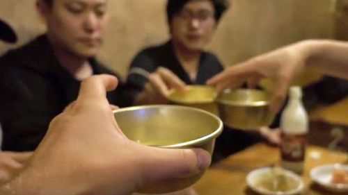 Jacob Laukaitis sharing a meal with friends in South Korea. (YouTube)