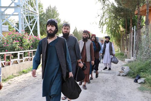 Afghanistan released the first 80 of a final 400 Taliban prisoners, paving the way for negotiations between the warring sides in Afghanistan's protracted conflict