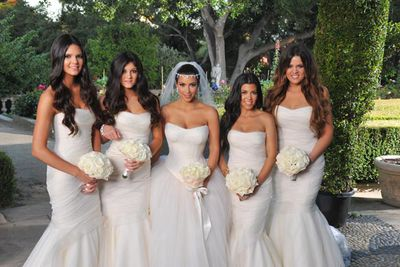 Kim's sisters were a ready-made bridal party: Kendal Jenner, Kylie Jenner, maid of honour Kourtney Kardashian and matron of honour Khloe Kardashian. The bridesmaids wore ivory Vera Wang silk organza gowns.<br/><br/>Image: Snapper