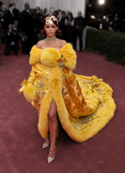 Rihanna in a custom-made gown by Chinese couturier Guo Pei at the 2015 Met Gala- China: Through the Looking Glass