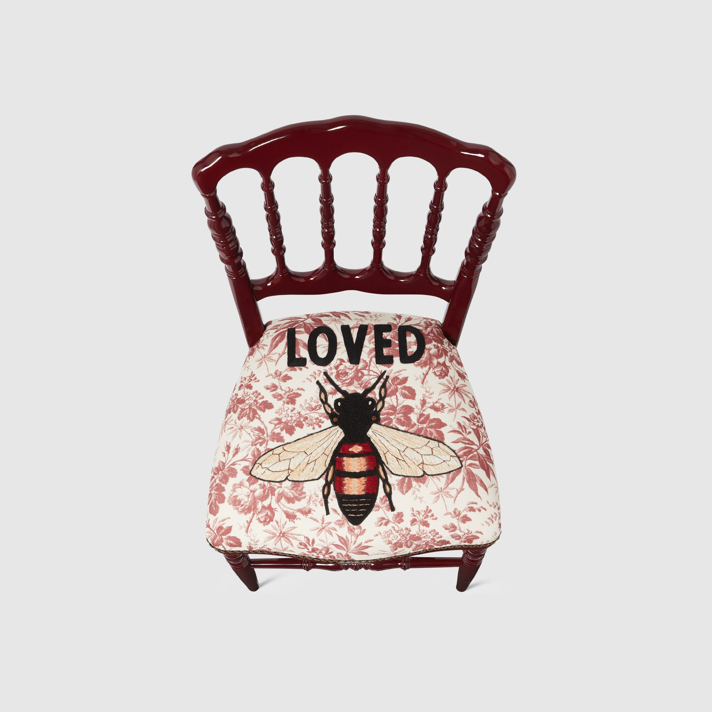 Wood chair with embroidered bee, $3,885
