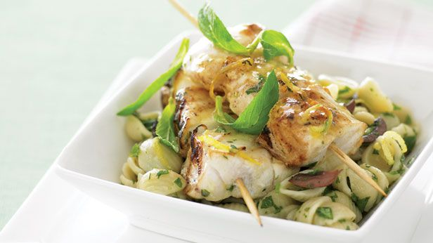 Fish skewers and warm pasta salad
