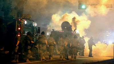Police attempt to control demonstrators protesting the killing of teenager Michael Brown. (Getty Images)