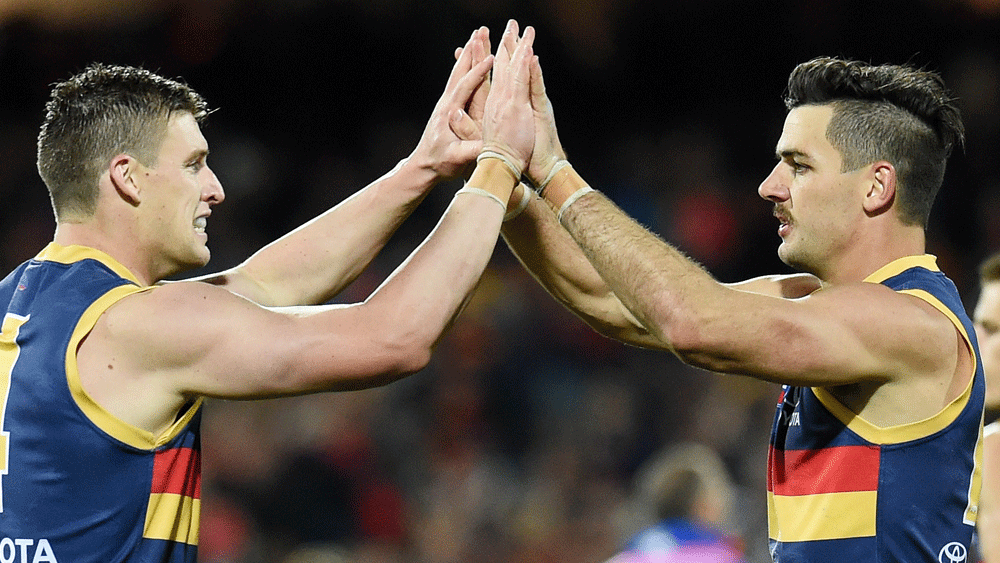 Taylor Walker (right) will captain the Crows in 20917. (AAP)