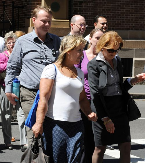Chris (left) and Mandy Burgess (centre) leave the King Street courts after listening to the first day of evidence into the stabbing murder of their 15-year-old daughter Tania Burgess, Sydney, Monday, March 10, 2008.
