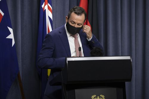PERTH, AUSTRALIA - JANUARY 31: Premier Mark McGowan arrives wearing a mandatory face mask to Dumas House Press Room on January 31, 2021 in Perth, Australia. Premier Mark McGowan has announced a five day lockdown across the Perth, Peel and South West regions of Western Australia, effective from 6pm local time on Sunday 21 January. The lockdown measures come following the discovery of a positive COVID-19 case in a worker at a quarantine hotel. (Photo by Matt Jelonek/Getty Images)