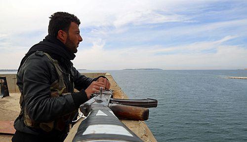 Misdirected coalition air strike kills 18 rebels fighting ISIS