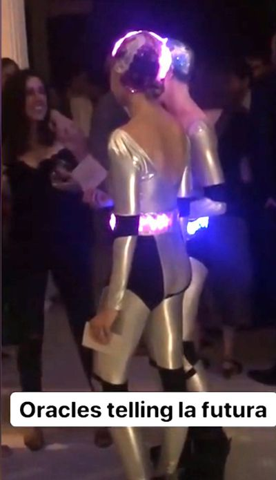 The wedding after party included a number of glitzy highlights including a neon limbo rope, a large disco ball, swings, and robotic 'oracles' who told guests their futures.