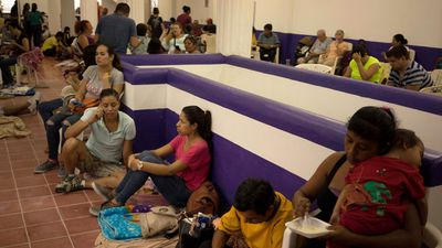 Residents and tourists shelter in a refuge in Puerto Vallarta. (AAP)