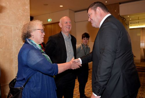James Packer meets Anna Bardsley who was a poker machine addict for ten years. Picture: Getty