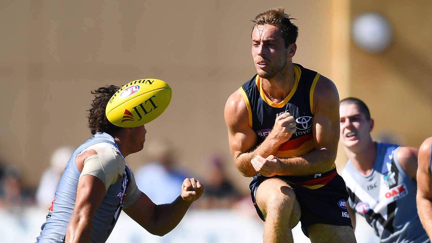 Richard Douglas of the Crows lays a bump on Steven Motlop of the Power