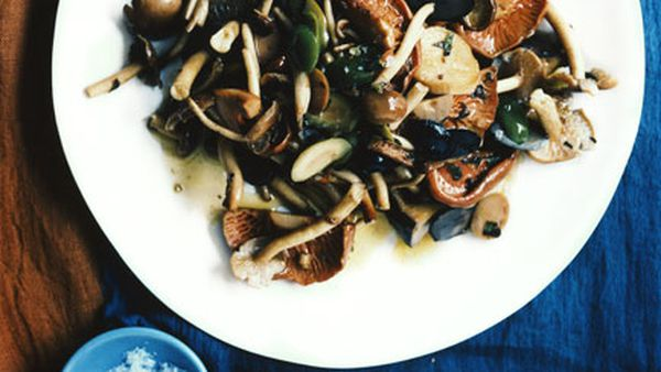 Warm salad of mushrooms with many olives