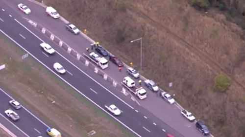Northbound traffic queued at least 12km on Sydney's M7 at Horsley Park after six-vehicle accident