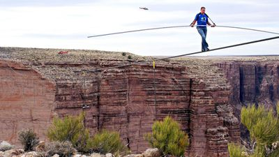 Wallenda near the end of his quarter mile walk over the Little Colorado River Gorge in Arizona in June 2013. The rope was 1500 feet above the chasm near the Grand Canyon. (AP Photos/Discovery Channel, Tiffany Brown)