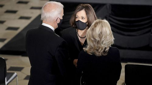 Democratic presidential candidate former Vice President Joe Biden and his wife Jill talk to Democratic vice presidential candidate Sen. Kamala Harris, D-Calif., before a memorial service in honor of Justice Ruth Bader Ginsburg as she will lie in state in Statuary Hall of the U.S. Capitol, Friday, Sept. 25, 2020 in Washington