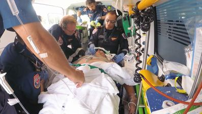 Matt performs surgery in the back of an ambulance to save motorbike rider