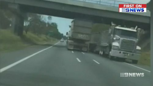 A Queensland driver has filmed the moment a rogue truck driver almost collided with dozens of oncoming cars on a busy highway.