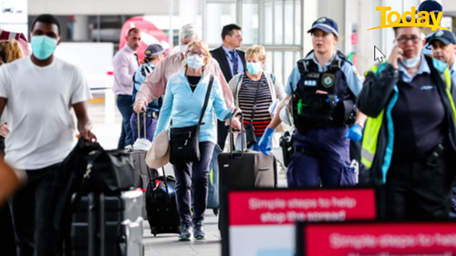 Buses taking people away for quarantine after they have arrived home from overseas. at Sydney airport in a file photo.