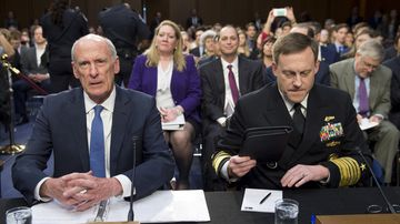 National Security Agency (NSA) Director Michael Rogers (R) and Director of National Intelligence Dan Coats (L) testify during a Senate Select Intelligence Committee hearing on the Foreign Intelligence Surveillance Act on Capitol HIll in Washington, DC, June 7, 2017. (AFP)