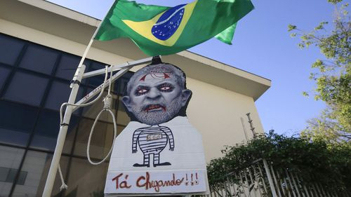 View of a caricature of former Brazilian President Luiz Inácio Lula da Silva in front of the Lula Institute in Sao Paulo, (EPA)