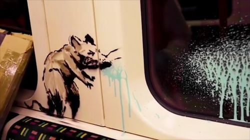 Banksy tags a coronavirus message on the London Underground