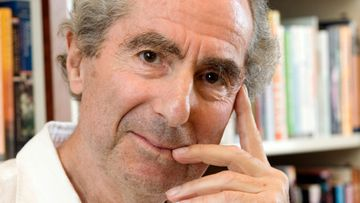 Philip Roth poses for a photo in the offices of his publisher Houghton Mifflin, in New York.