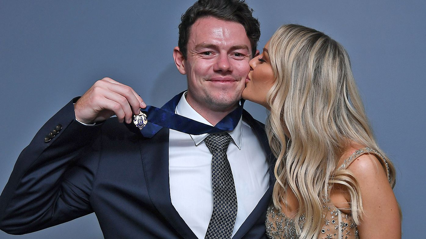 Lachie Neale of the Lions poses with his wife Julie Neale after winning the Brownlow Medal