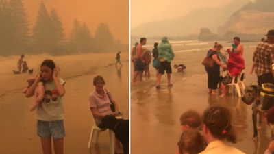 Families huddled on orange beach to escape bushfire