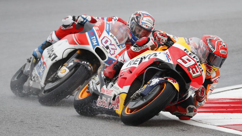 Andrea Dovizioso wins Malaysian MotoGP to keep title race alive