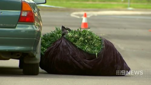A large bag of drugs was dumped by one of the men who fled. (9NEWS)