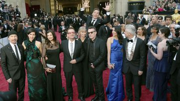 Click through to see more epic photobombs like this one of Benedict Cumberbatch dropping in on U2 (AAP).