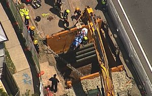 Man pulled to safety after falling six metres down hole at Brisbane worksite