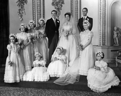 Princess Anne stands in front of the best man as a bridesmaid at the wedding of Princess Margaret and Antony Armstrong-Jones on May 6, 1960.