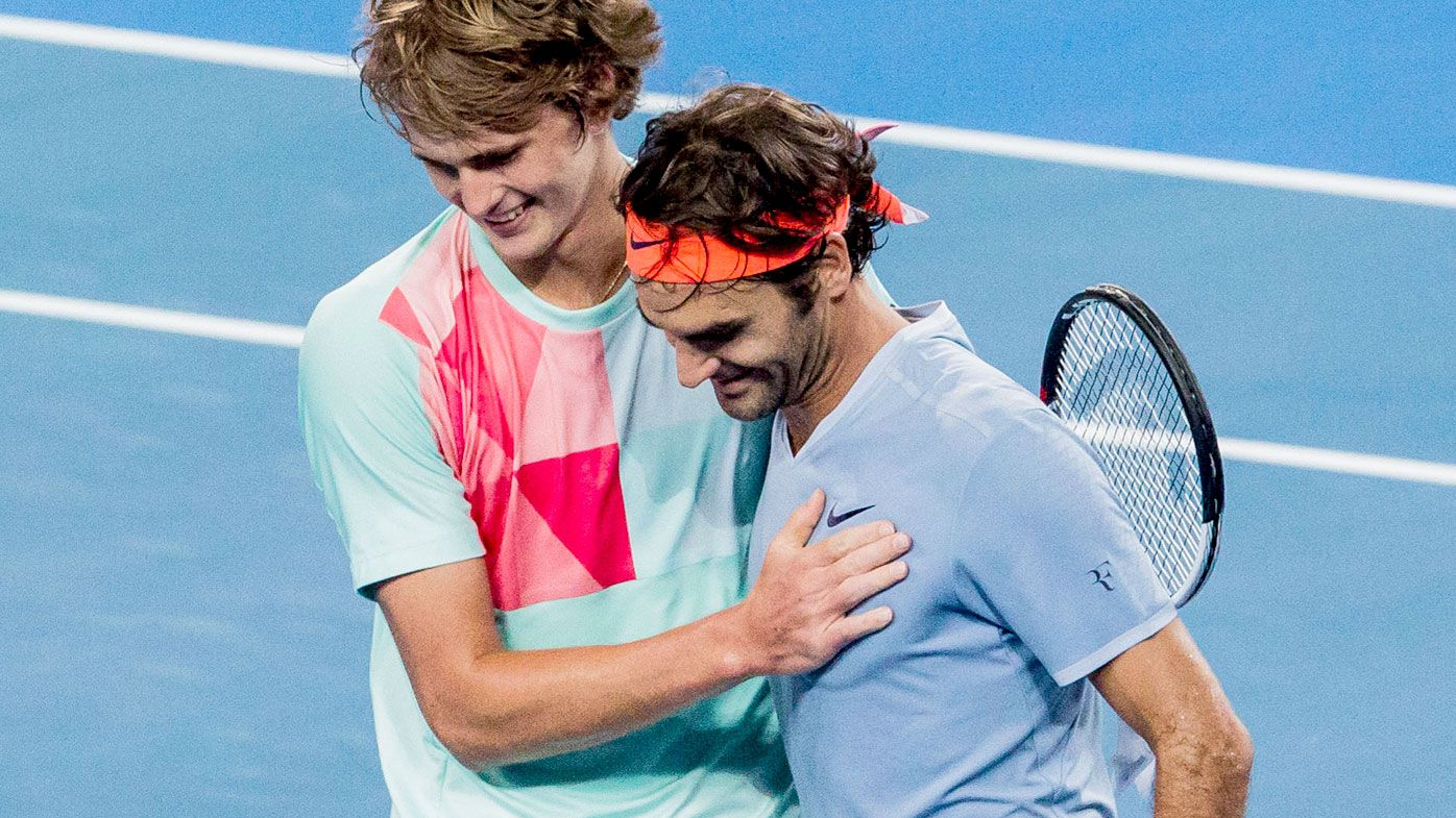 German teen Alexander Zverez embraces Roger Federer after beating the Swiss champion in three sets at the Hopman Cup in Perth. (AAP)