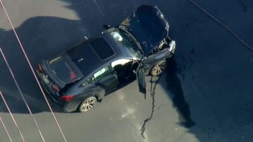 The emergency services vehicle collided with a black BMW. (9NEWS)